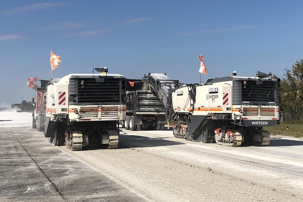 Road milling white truck